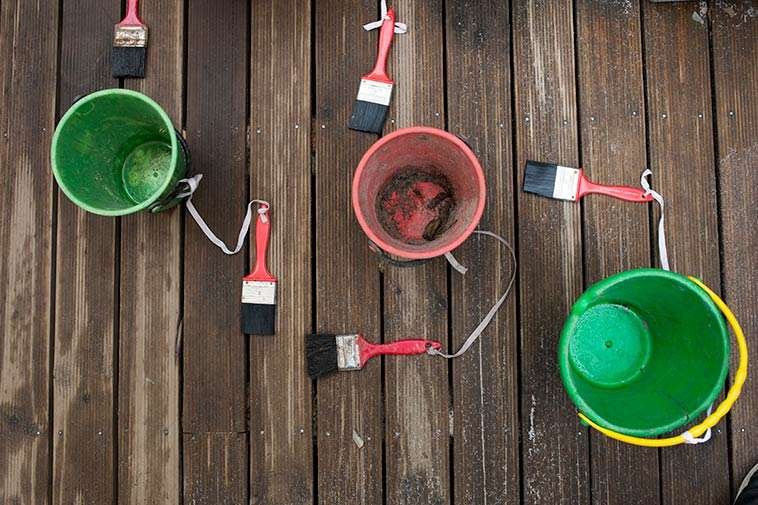 Buckets And Paint Brushes At Batman Park Kindergarten. Photography By Birdhouse Digital.