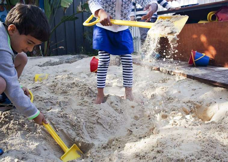 Kids Playing In The Sandpit In The J.S Grey Kindergarten Outdoor Play Area.